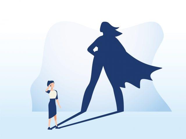 illustration d'un femme dont l'ombre la représente avec uen cape d'héroïne